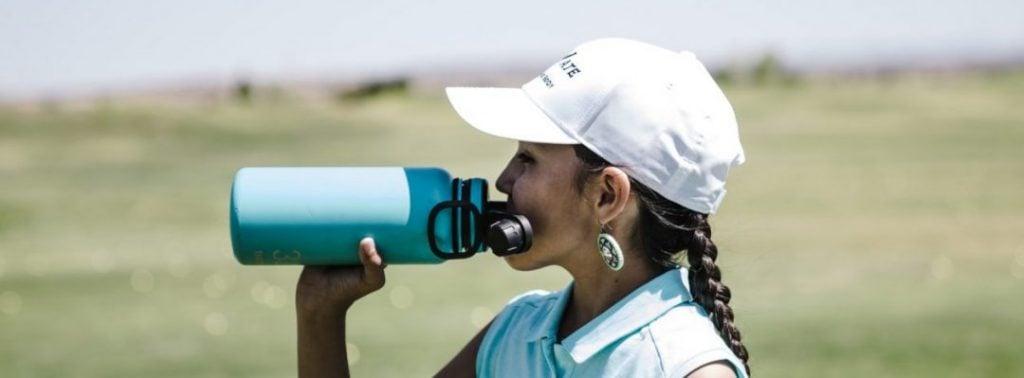 Golfing Woman Drinking Protein Shake