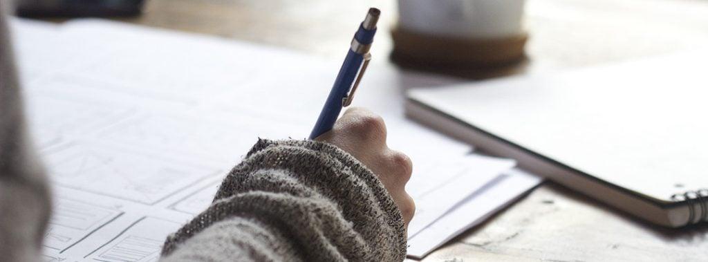 Closeup of a hand holding a pen