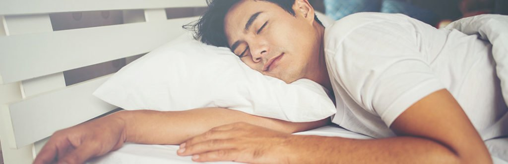man sleeping on shoulder