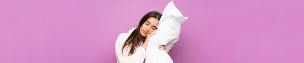woman holding neck roll pillow