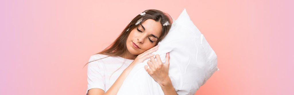 sleepy woman holding pillow