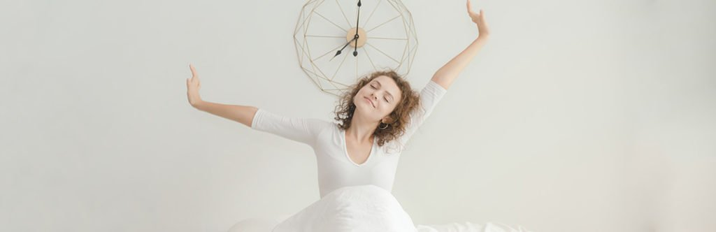 woman stretching after restful sleep